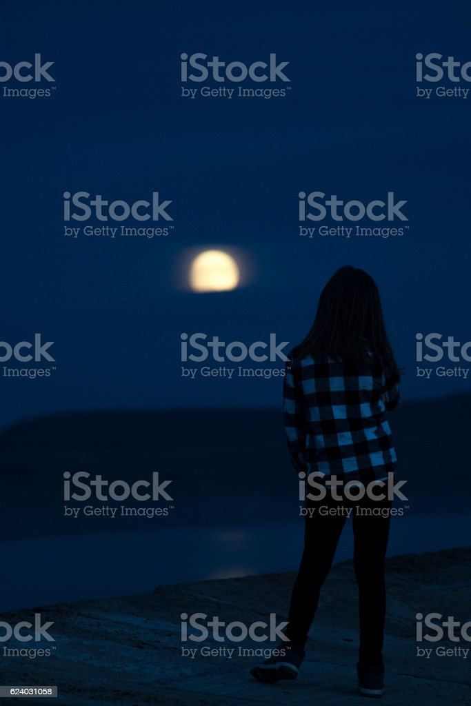 Looking at the moon stock photo