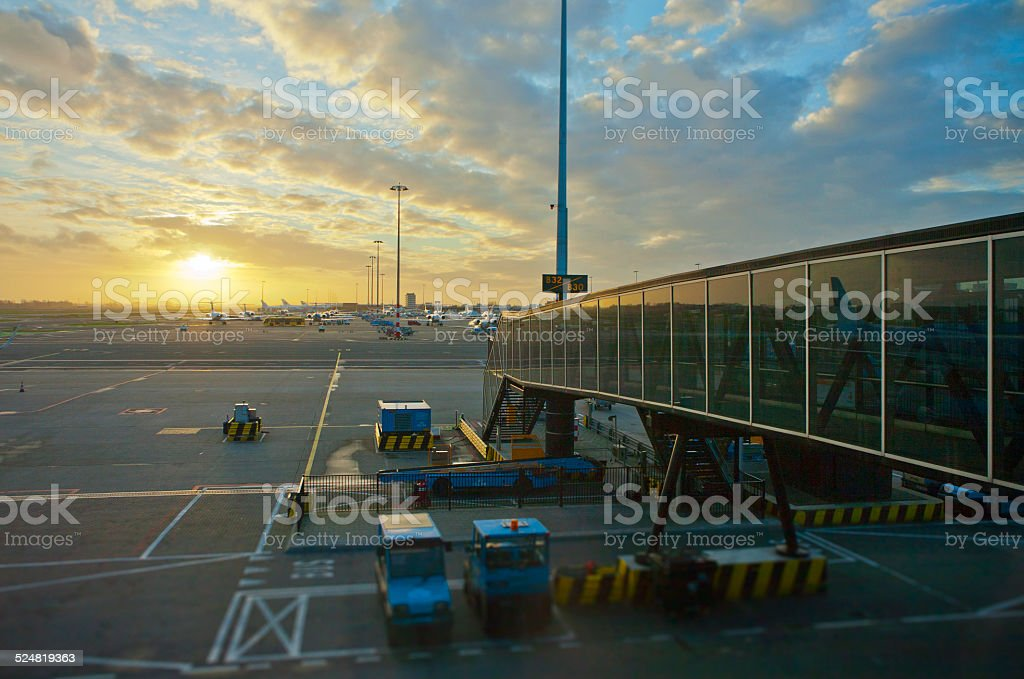 Looking at the morning sun from airport gate stock photo