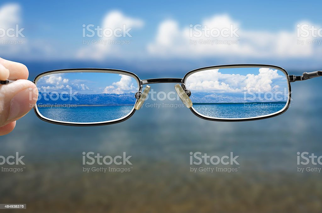 looking at the sea through the glasses stock photo
