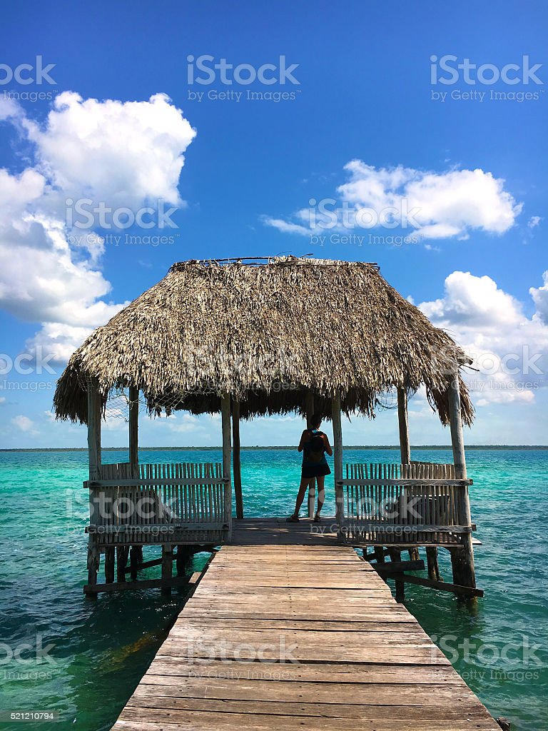 Looking at turquoise water stock photo
