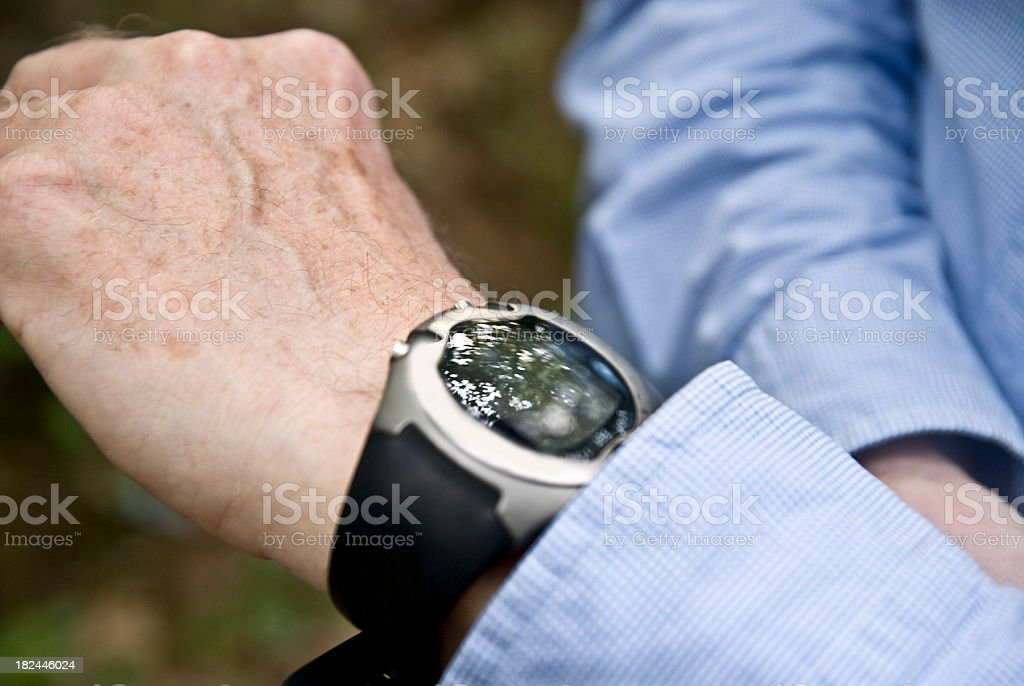 looking at wristwatch on human arm stock photo