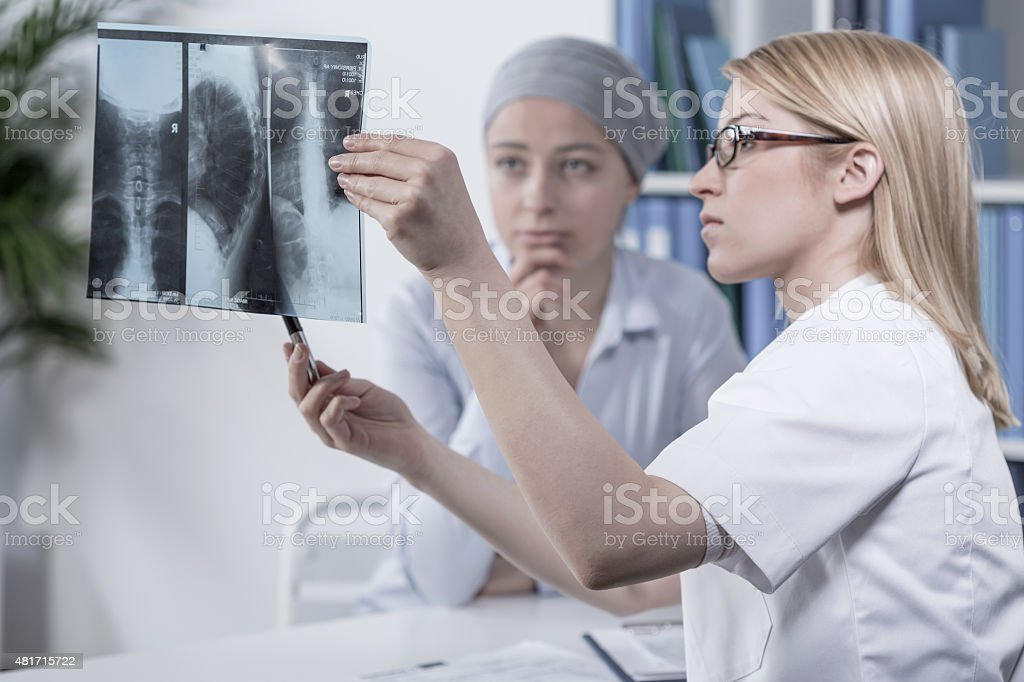 Looking at xray stock photo