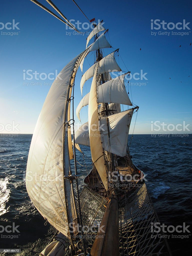 looking back at sails of a traditional tallship stock photo