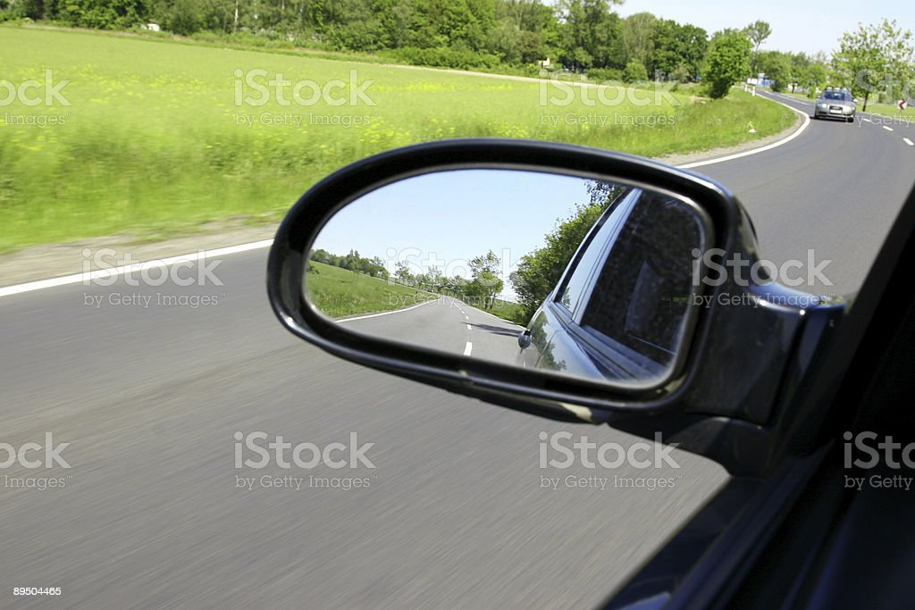 Looking back, driving straight royalty-free stock photo