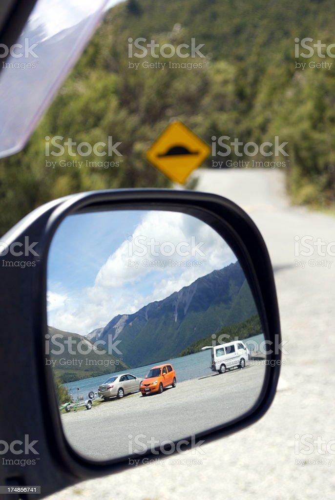 Looking Back in a Car Mirror royalty-free stock photo