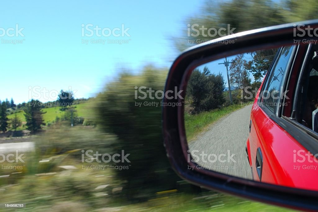 Looking Back in a Car Wing Mirror royalty-free stock photo
