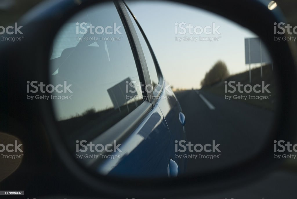 Looking back through a side view mirror stock photo