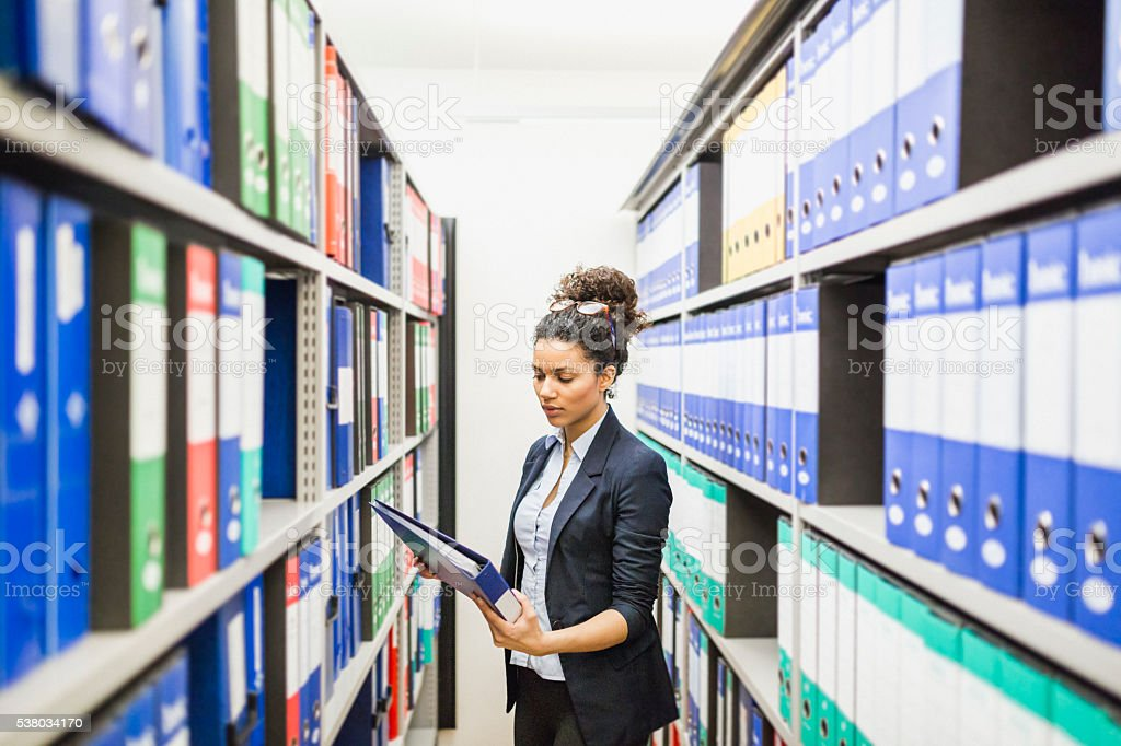 Looking documents in paper archive stock photo