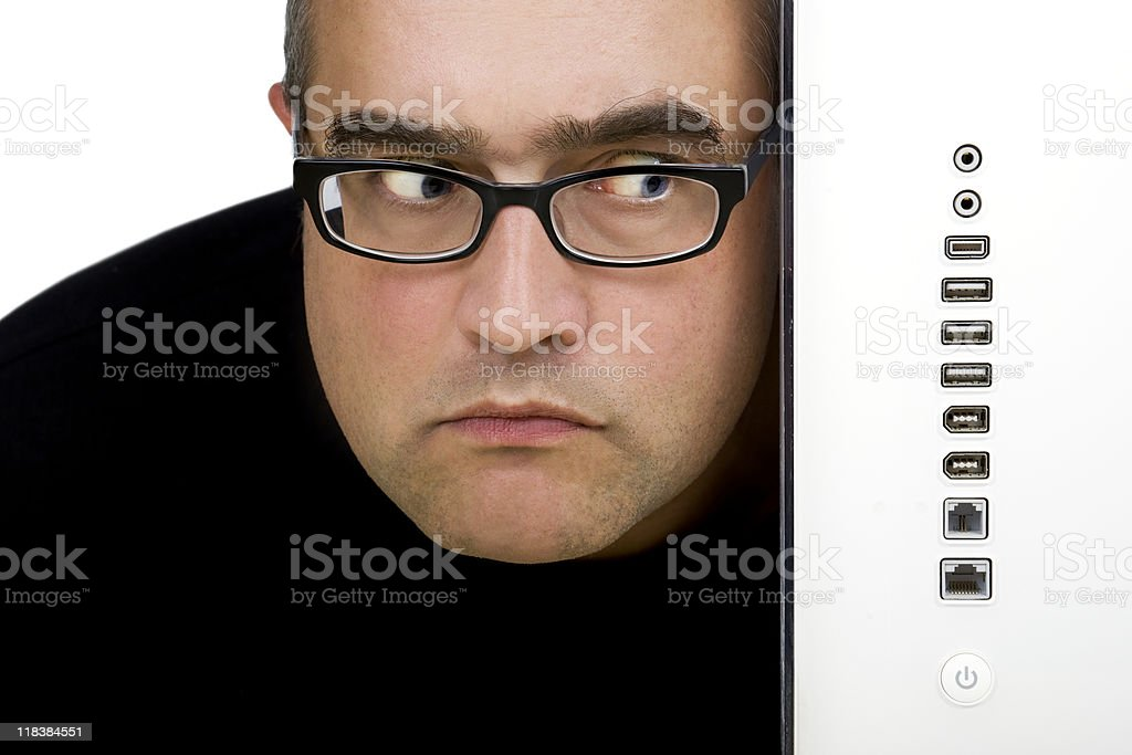 Looking doubtful at the computer ports royalty-free stock photo