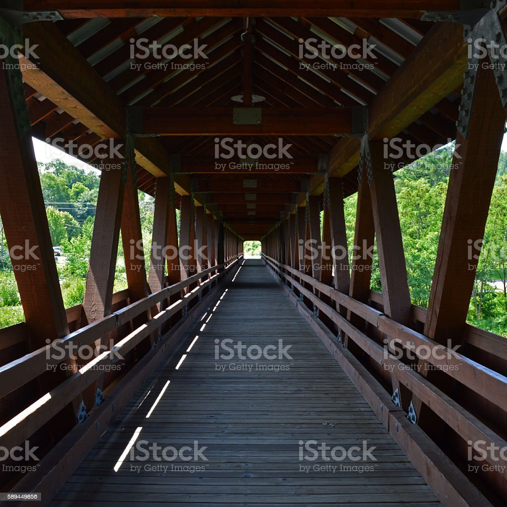 Looking down a covered bridge stock photo