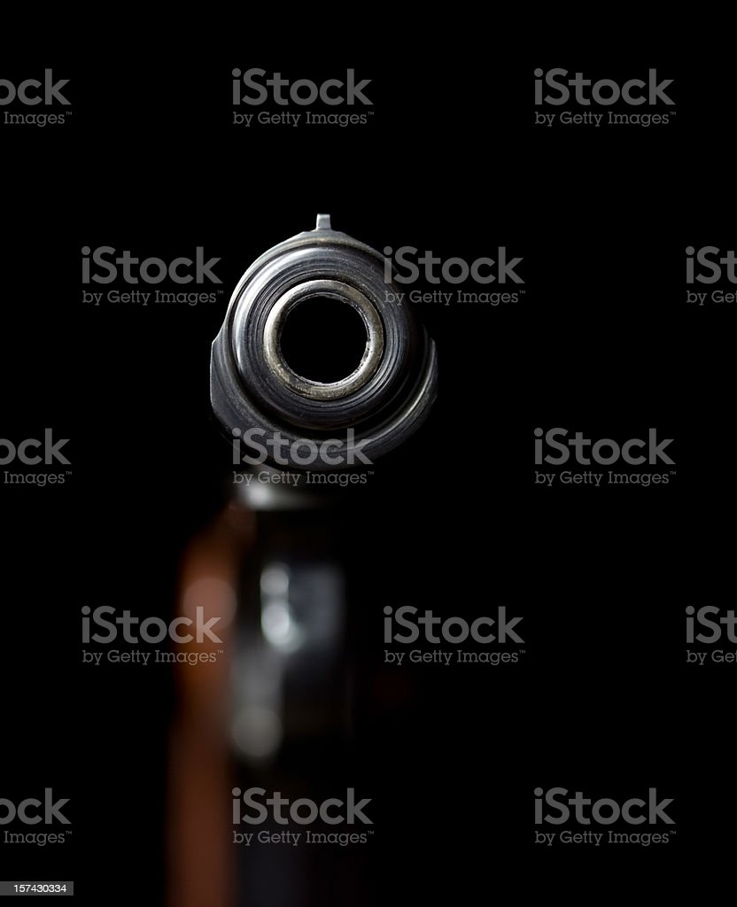 Looking Down a Handgun Barrel on Black royalty-free stock photo