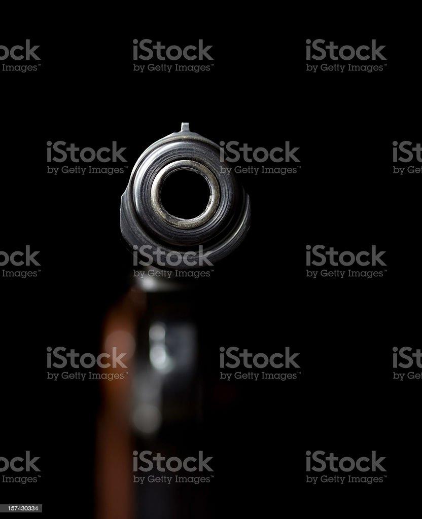 Looking Down a Handgun Barrel on Black stock photo