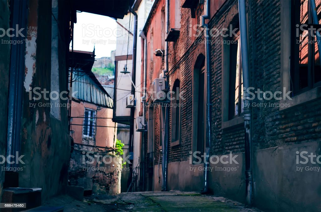 Looking down an empty inner city alleyway stock photo