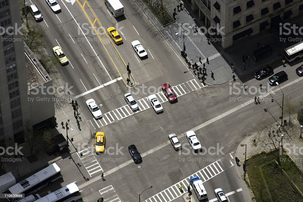 Looking Down At Downtown Intersection with Cars stock photo