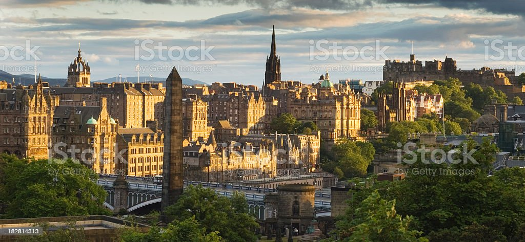 Looking down at Edinburgh as the sun sets over the city stock photo