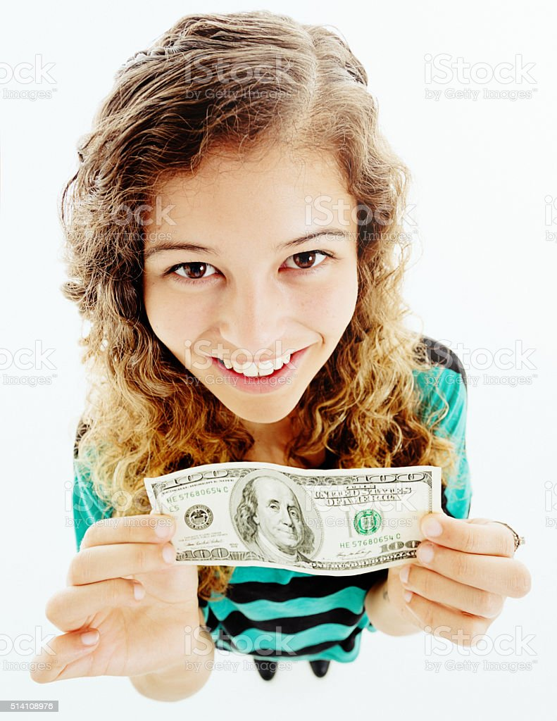 Looking down at happy young woman holding 100 dollar bill stock photo