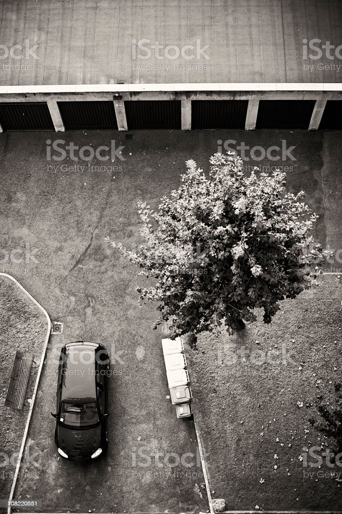 Looking Down at Parking Lot with Car, Black and White royalty-free stock photo