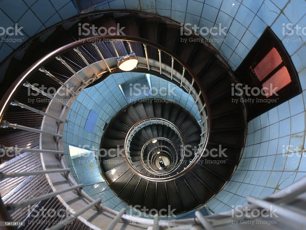 Looking Down at Spriral Staircase Inside Light House royalty-free stock photo