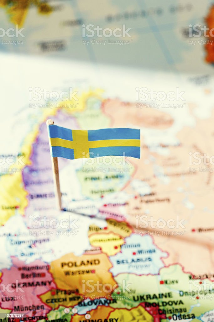 Looking down at Swedish flag marking Sweden on European map royalty-free stock photo