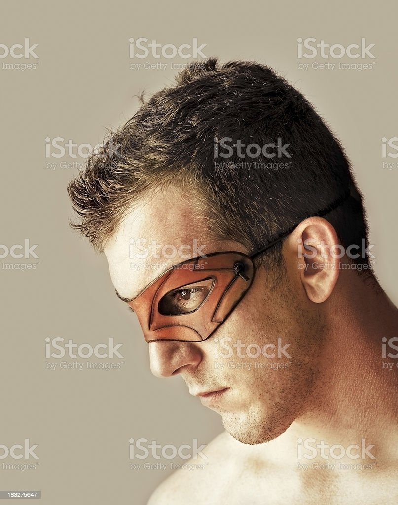 looking down man with leather mask royalty-free stock photo