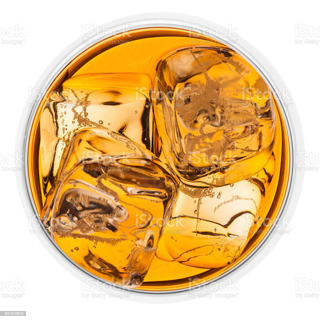 Looking down on a glass of whisky with ice stock photo