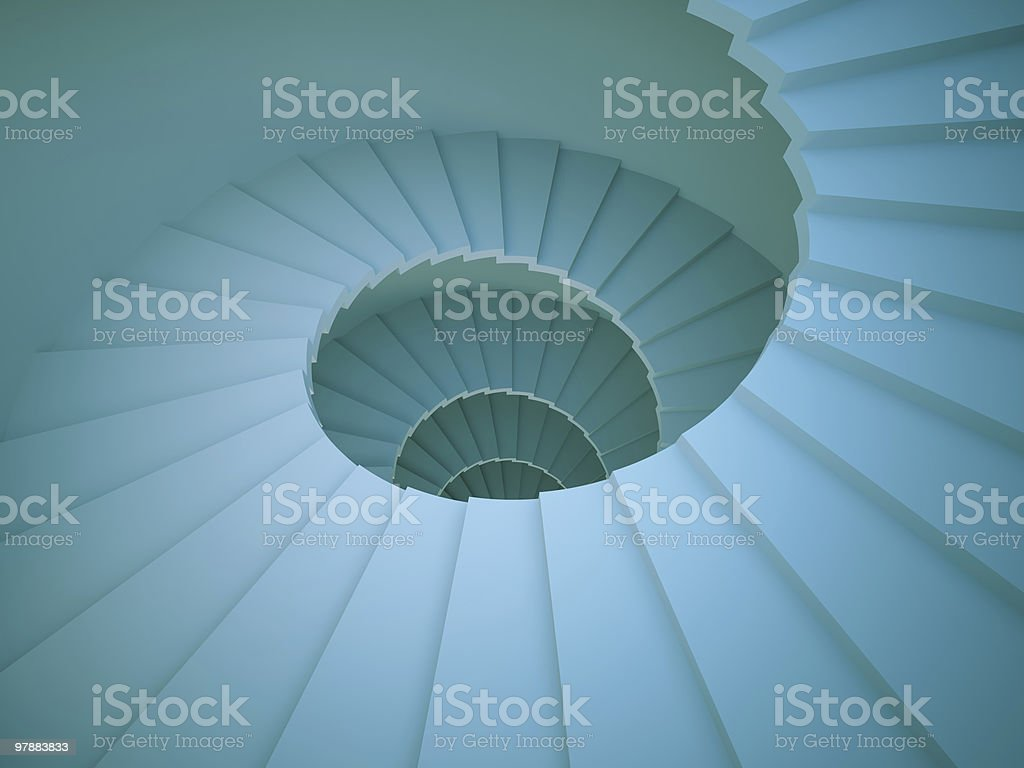Looking down on a long spiral staircase stock photo