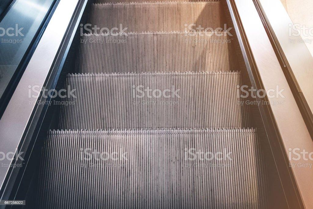 looking down on escalator stock photo