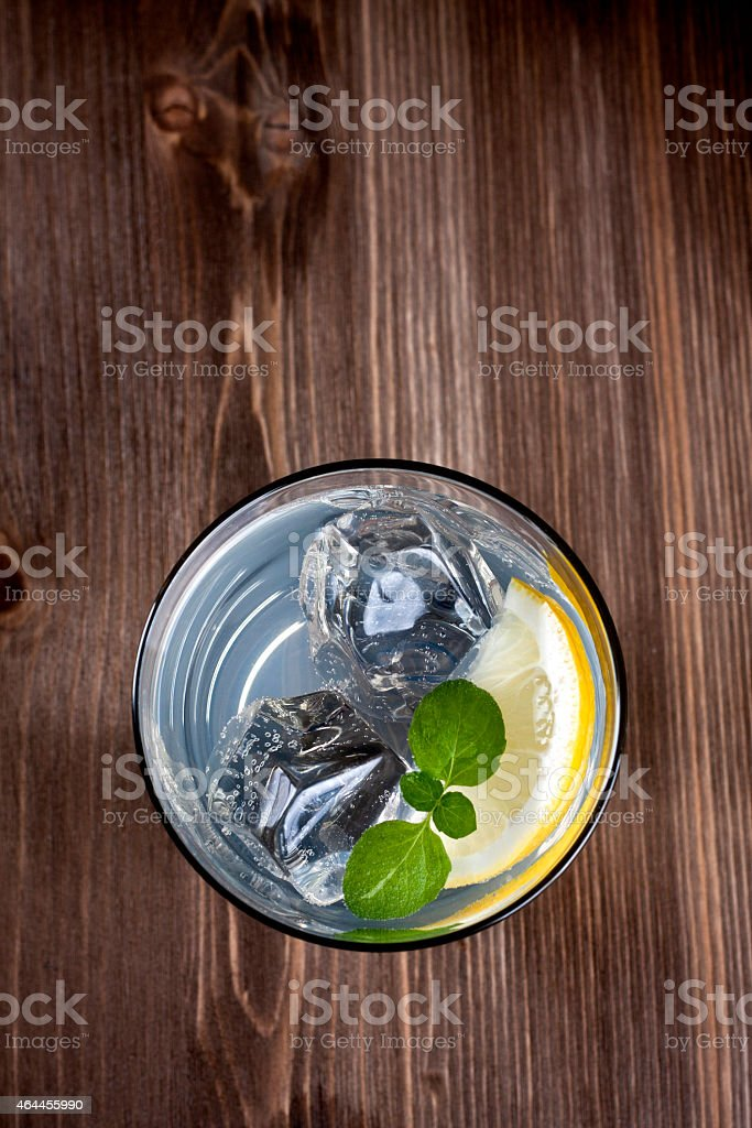 Looking down over cold drink in a glass stock photo