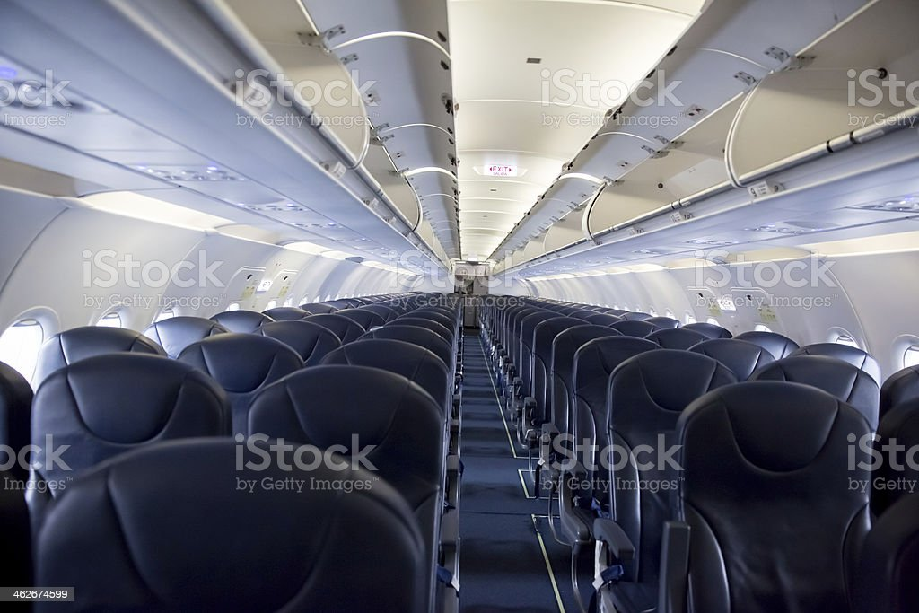 Looking down the aisle a of empty passenger jet. royalty-free stock photo