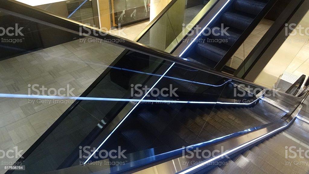 Looking down the escalators stock photo