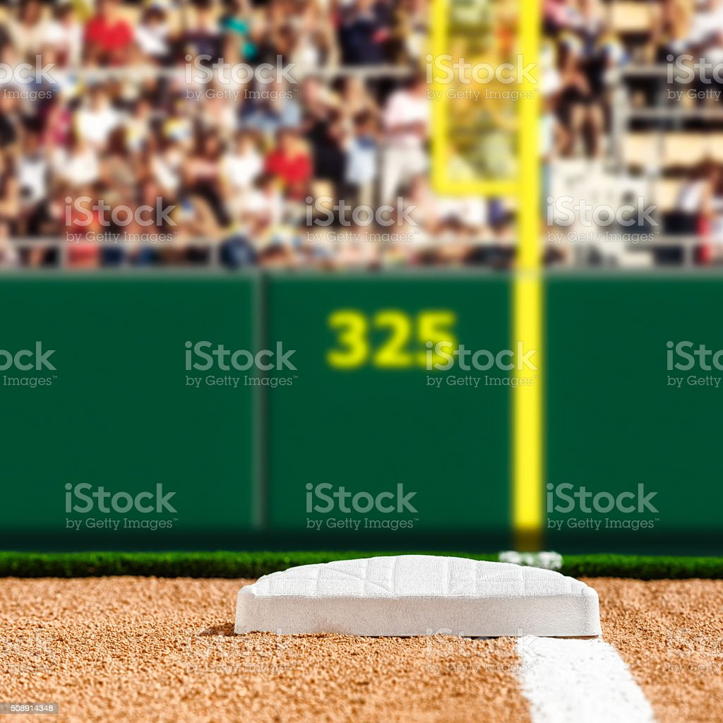 Looking down the foul line to first base, outfield wall stock photo