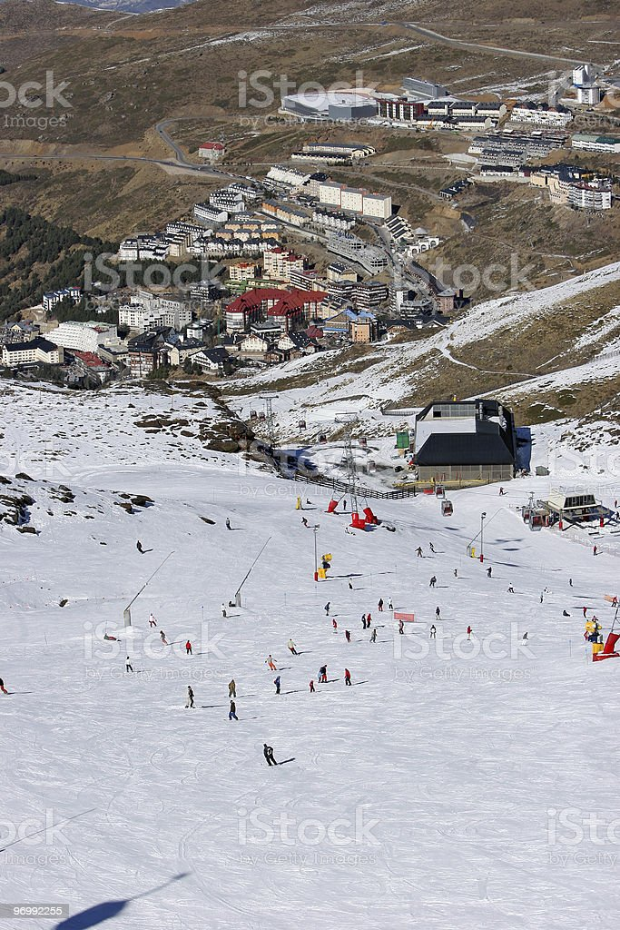 Looking down the ski slopes of the Sierra Nevada mountains in Sp royalty-free stock photo