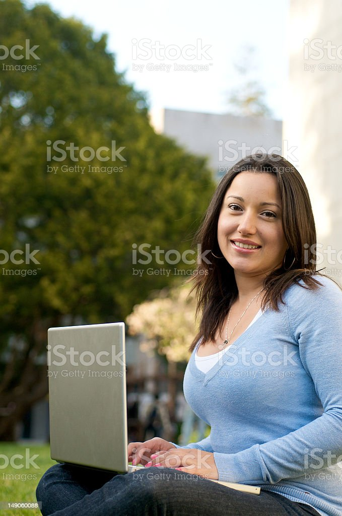 Looking Female Student with laptop on campus royalty-free stock photo