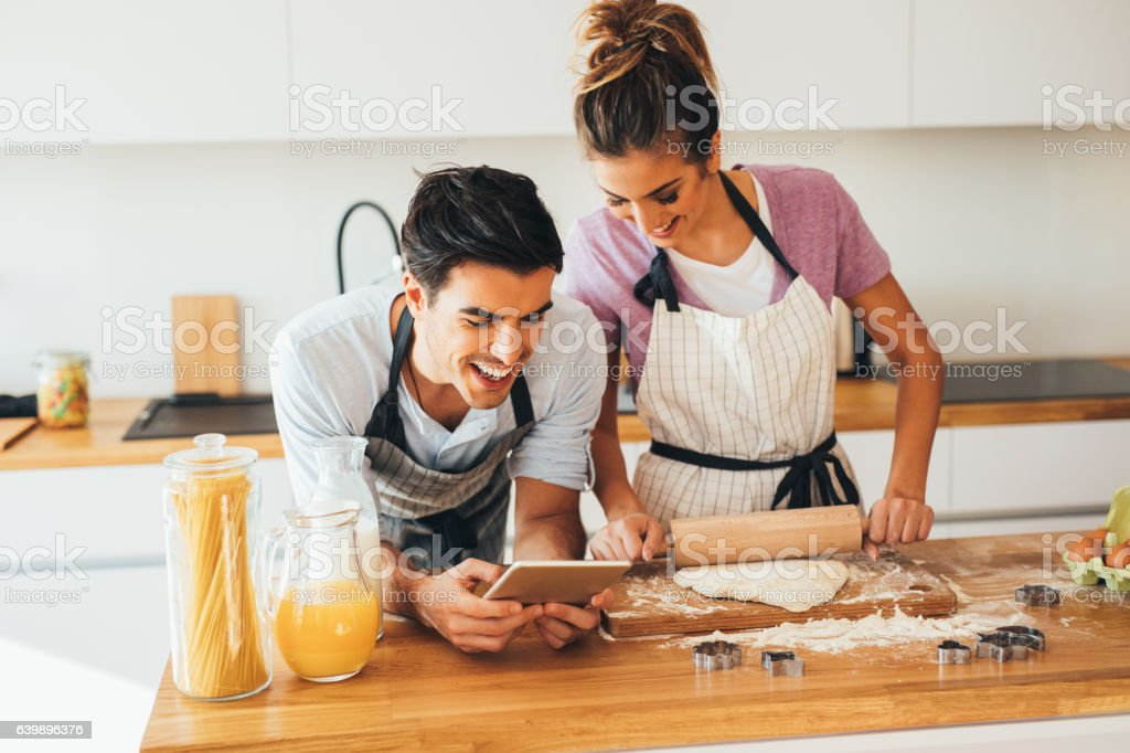 Looking for a recipe for cookies in the internet stock photo