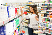 Looking for cosmetics in supermarket
