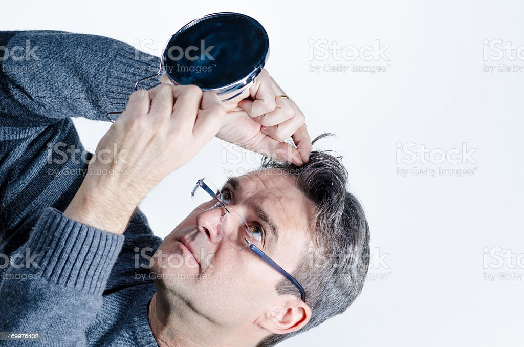 Looking for gray hair stock photo