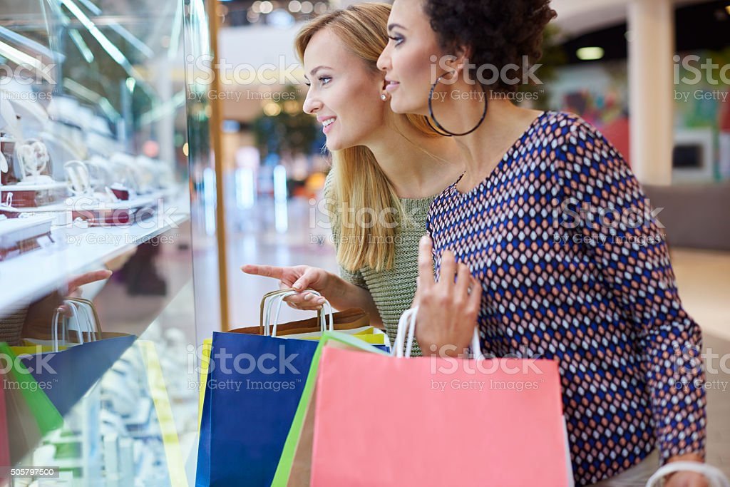 Looking for perfect jewelry on evening stock photo