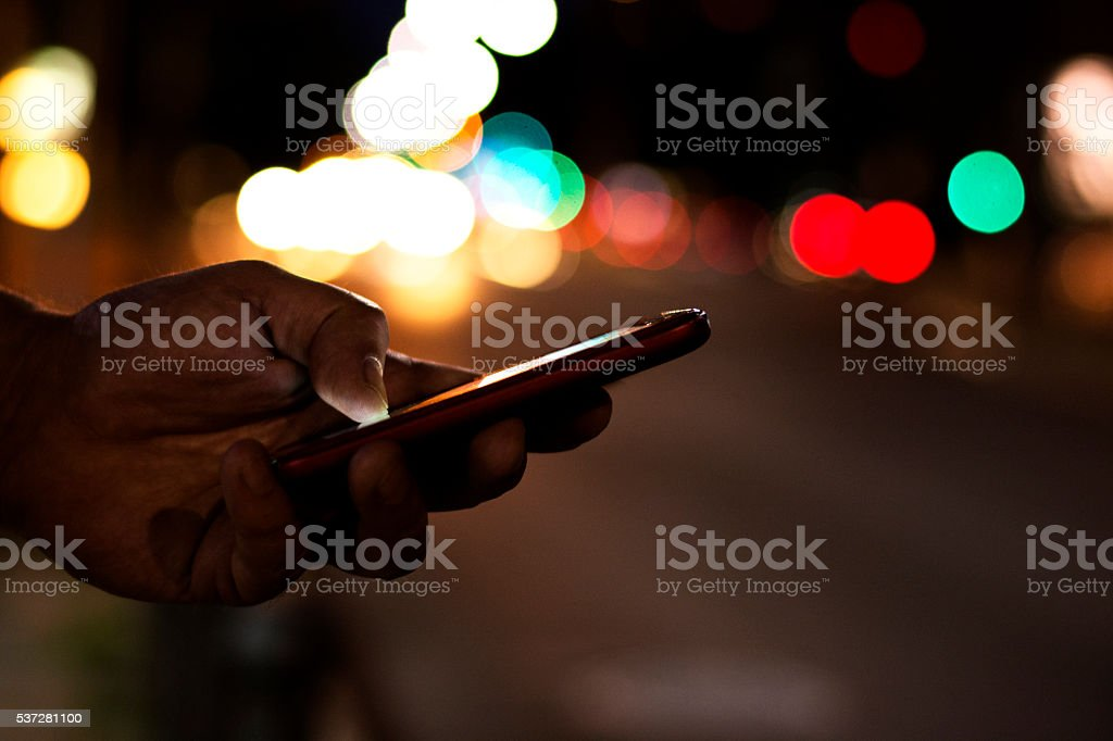 Looking for taxi online stock photo