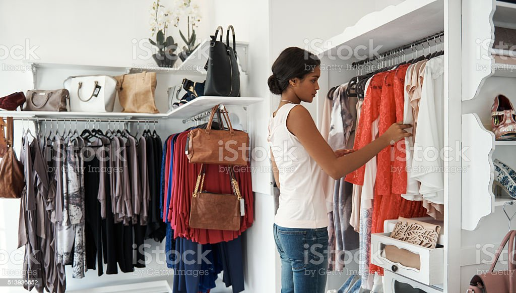 Looking for that perfect outfit stock photo