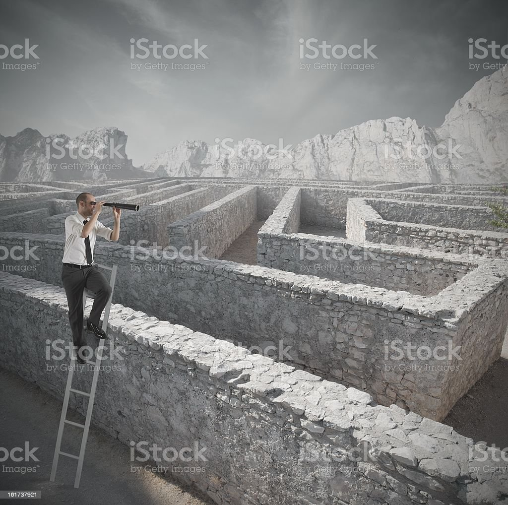 Looking for the solution to a maze stock photo