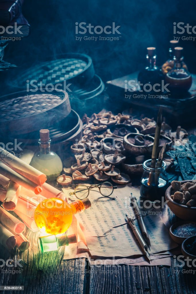 Looking for umami taste in vintage alchemist laboratory stock photo