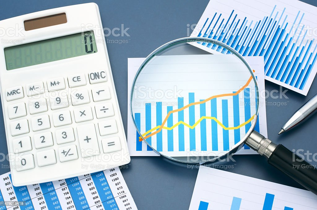 Looking graph with magnifying glass. Calculating and analyzing d stock photo