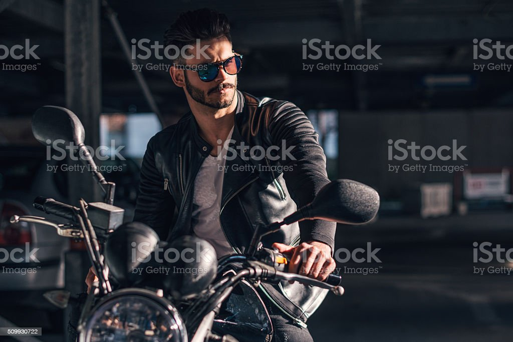 Looking great on his new bike stock photo