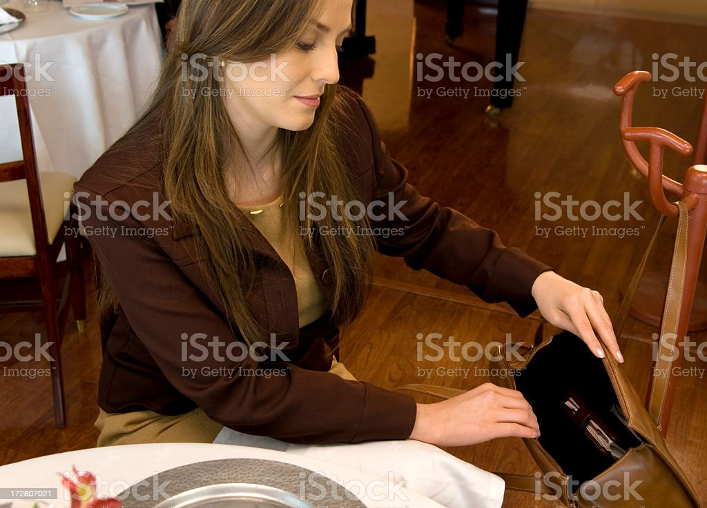Looking in her Purse royalty-free stock photo