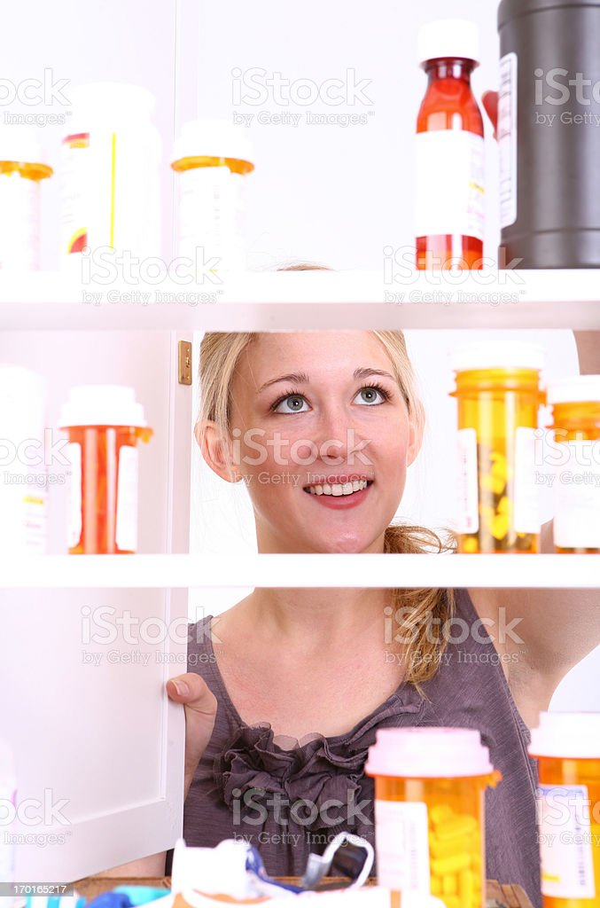 Looking in Medicine Cabinet stock photo