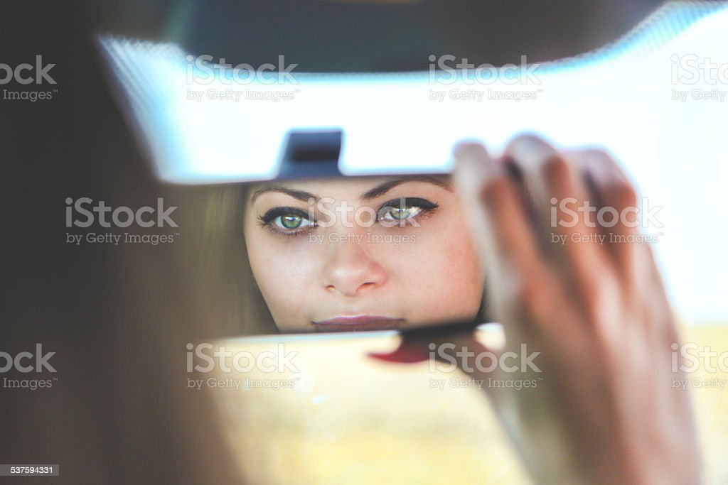 Looking in rearview mirror stock photo