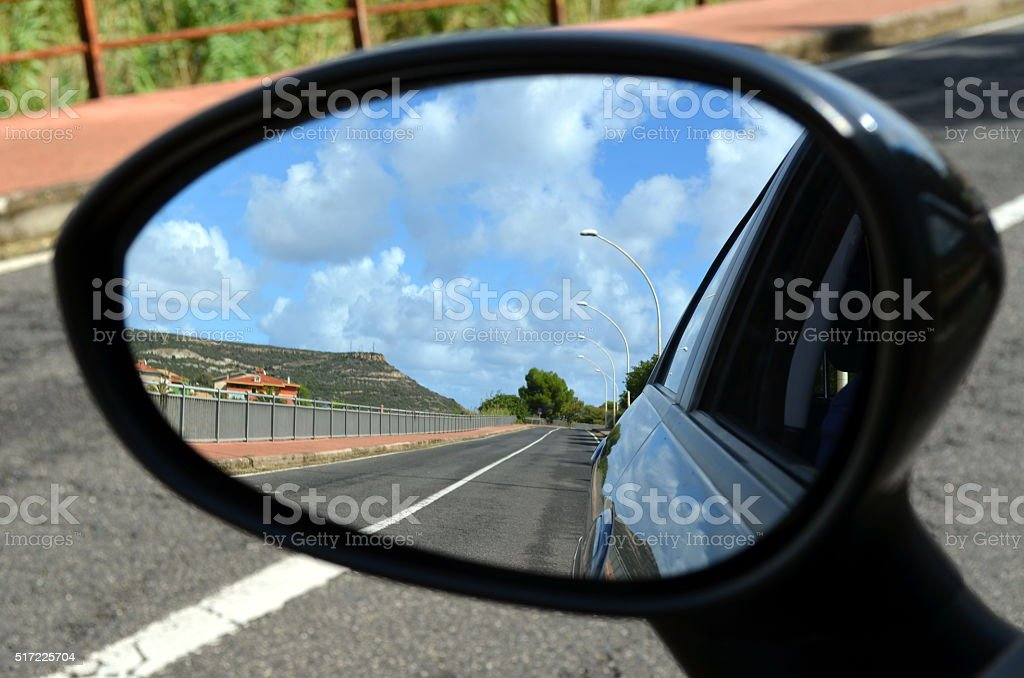 Looking in the car mirror at Sardinia island Italy stock photo