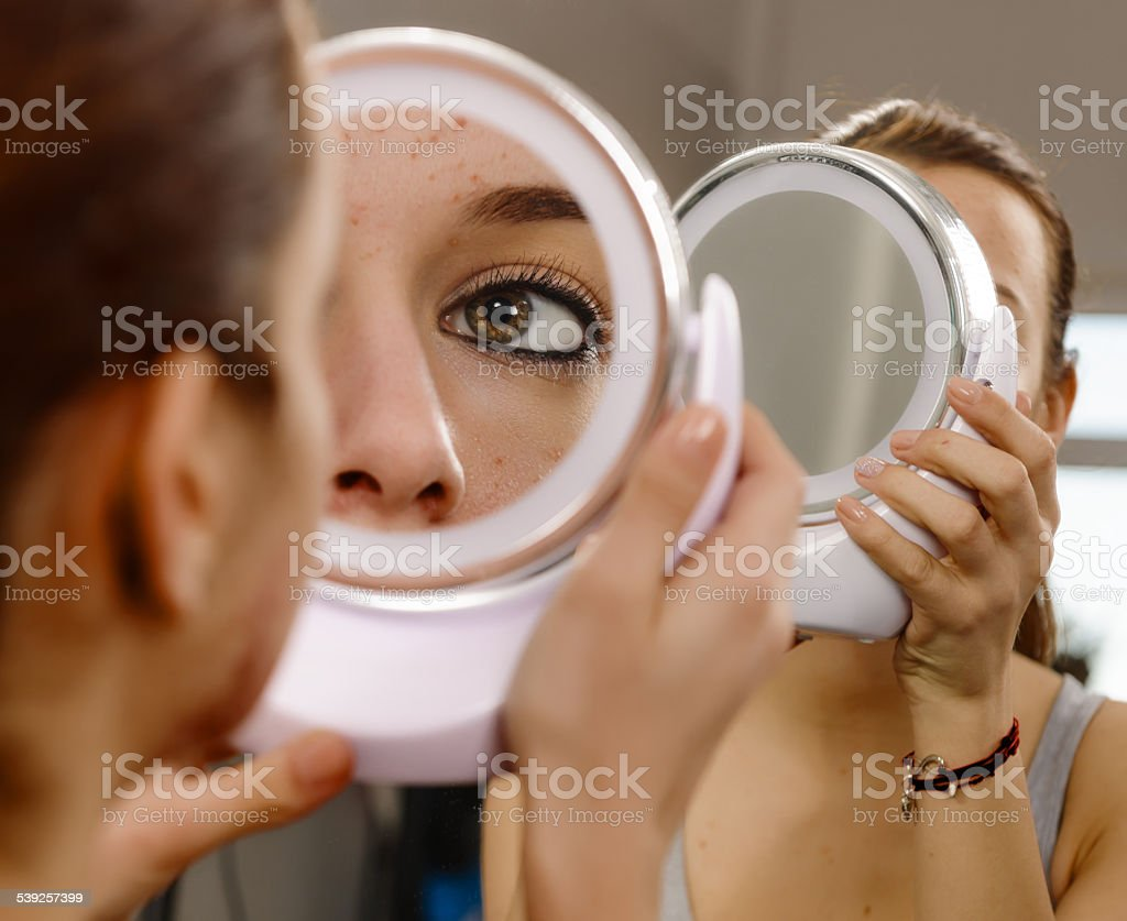 looking in the mirror stock photo