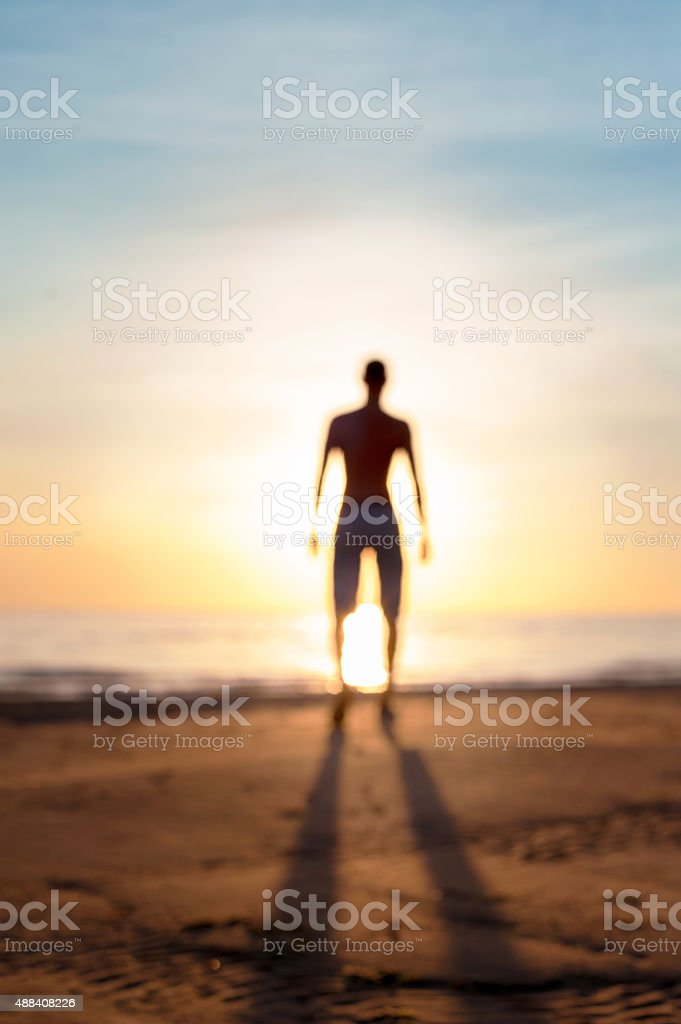 Looking into the future. Defocused blurred man silhouette in sunbeam. stock photo