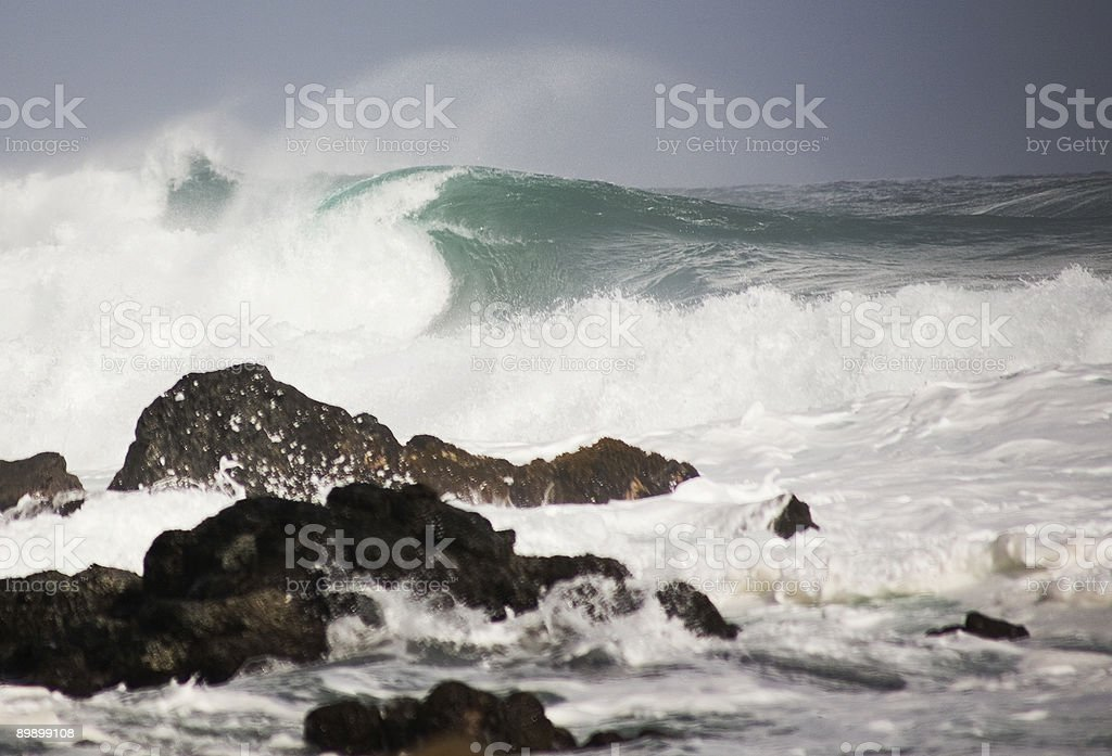 Looking into wave barrel, rocks foreground royalty-free stock photo